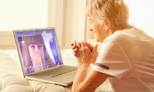 older woman talks to young girl on laptop