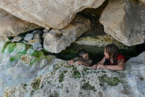 Muhammed and Hasret enjoy hot spring water in the Botan valley a few miles from the Ilisu dam, near the city of Siirt