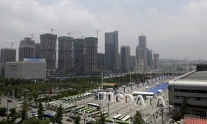 Big Data Expo, near residential buildings under construction, in Guiyang