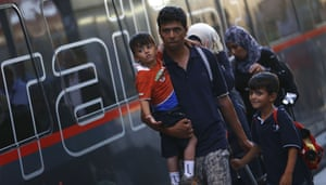 A family disembarks from a Railjet train from Austria