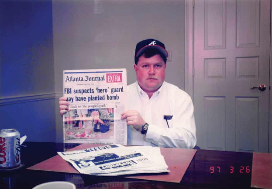 Richard Jewell holding a copy of the paper naming him as a suspect