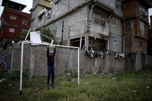 Nicolas Suarez hangs from a goalpost