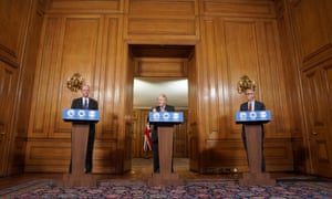 Left to right: Chris Whitty, Boris Johnson and Patrick Vallance at the press conference.