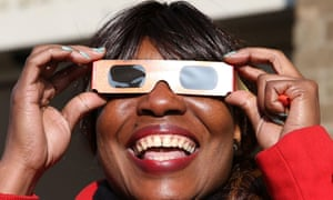 Solar Eclipse. A woman watches an eclipse of the sun outside the Broadmarsh Shopping Centre, in Nottingham. PRESS ASSOCIATION Photo. Picture date: Friday March 20, 2015.