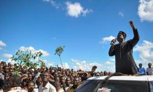 Opposition leader Raila Odinga gives an address