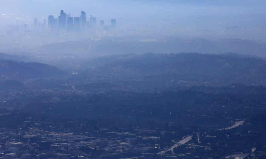 Buildings of downtown Los Angeles partially obscured at midday.