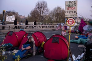 Activists occupy the bridge early in the morning on Good Friday