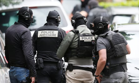 Police officers during an operation to arrest the suspects, in Oullins, near Lyon.