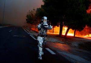 A firefighter wears a flame-resistant suit in Rafina