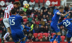 Stoke City striker Peter Crouch (L) climbs to head home their second goal.