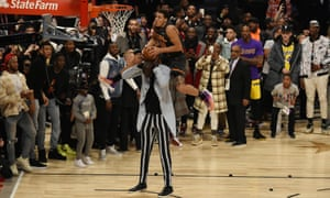 Aaron Gordon leaps over Tacko Fall in the slam dunk contest during NBA All Star Saturday Night at United Center
