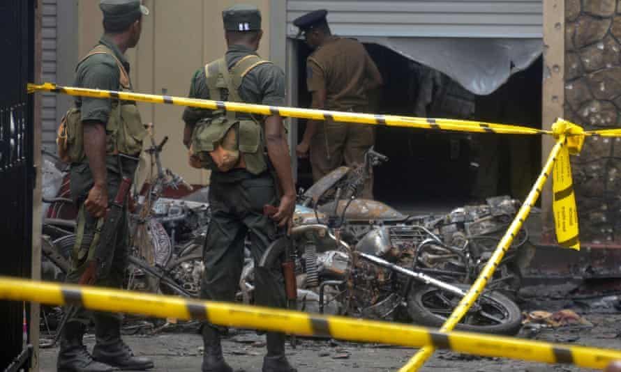 Members of the Sri Lankan military stand guard near an explosion site at a church in Batticaloa