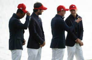 Tiger Woods (far left) looks dejected