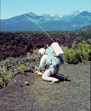 Collecting soil samples at Bonita Lava Flow near Sunset Crater Volcano national monument, June 1964. San Francisco Peaks are in the background.