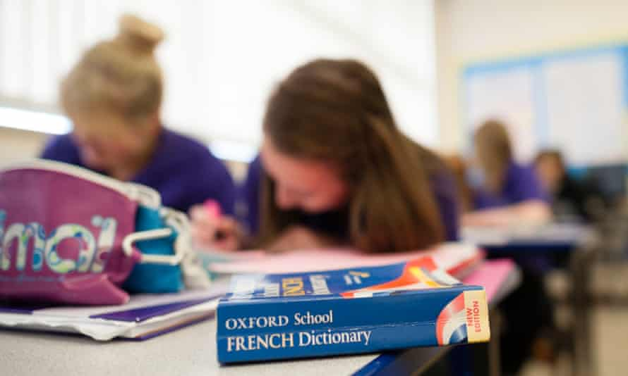 GCSE pupils learning studying french language in a class at a secondary comprehensive school