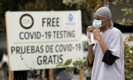 A man takes a coronavirus test at a mobile site at the Charles Drew University of Medicine and Science, in Los Angeles.