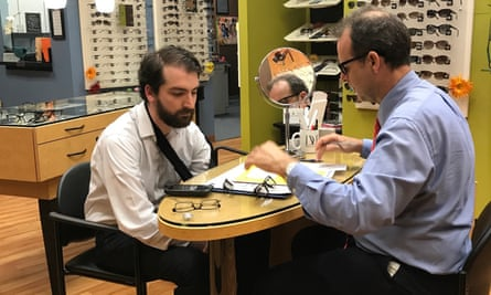 Ben Jacobs being fitted for new glasses with optician Russell Byron.