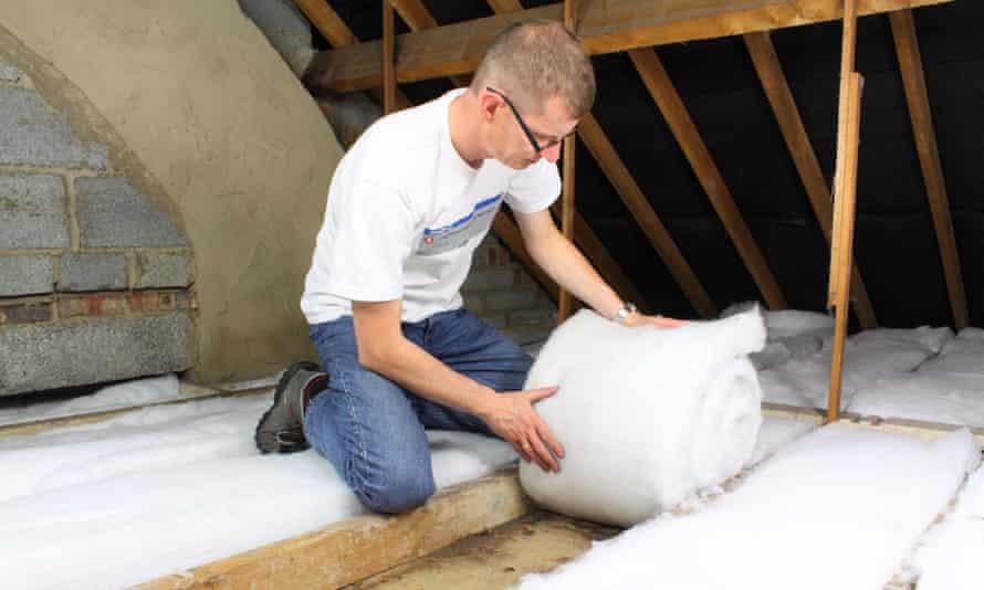 a man lays loft insulation