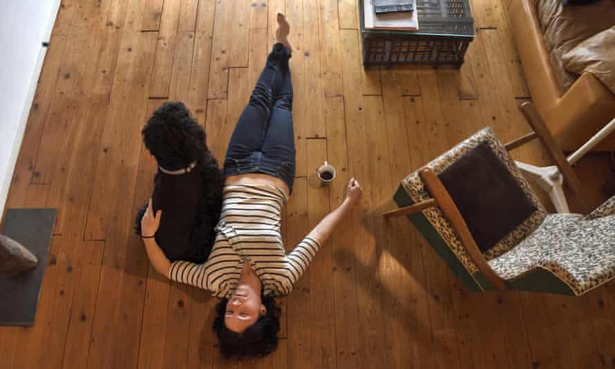 Woman lies on floor
