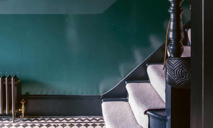 A hallway with a gloss 'tide line' painted up to an imaginary dado rail, with matte paint in the same colour.