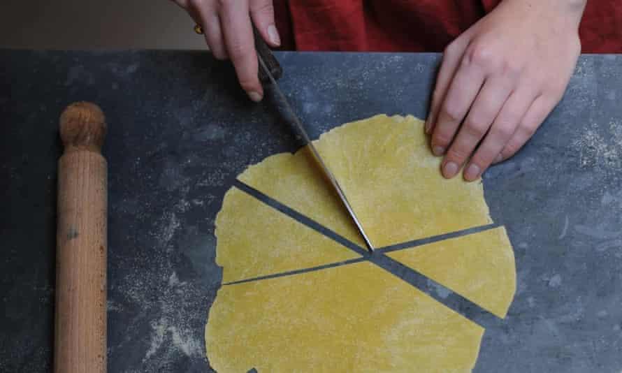 Flat pasta cut into pieces