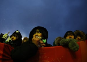 Spectators wait for the start of a medal ceremony