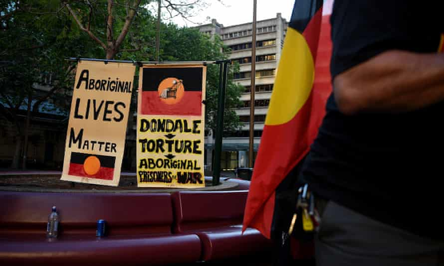 Justice rally with signs reading, 'Aboriginal lives matter' and 'Dondale - torture - Aboriginal prisoners of war'.