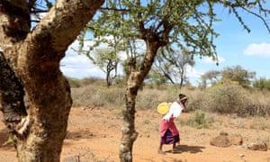 Woman walking in Magadi, Kenya