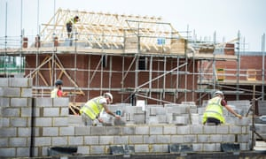 Workers building affordable housing