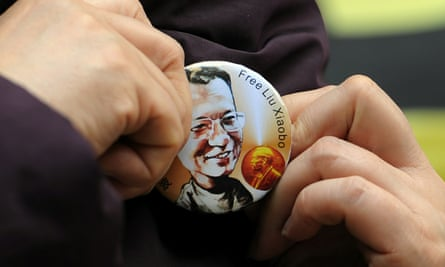 A woman wears a badge asking for the release of Liu Xiaobao outside the legislative council in Hong Kong, in 2010.