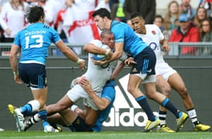 Joseph crashes through Italy's defence to score his team's fourth try and complete his hat-trick.