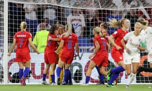 US goalkeeper Alyssa Naeher is congratulated by her teammates after saving Steph Houghton's penalty.