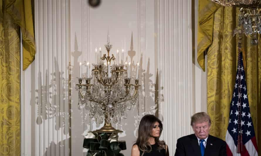 Melania and Donald Trump attend a Hanukkah reception at the White House.