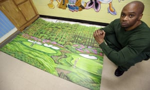 Valentino Dixon poses with his golf art in Attica, New York, on 16 May 2013.