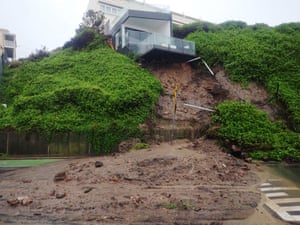A Newcastle house after some of its foundations fell away in a landslip, forcing a road to be closed
