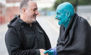 Spencer Tunick shakes hands with Stephane Janssen, one of the participants in Sea of Hull