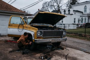 Holden Hakeos, 16, works on his '73 Chevy c10 on 14 January 2019 in Monroe, Michigan.