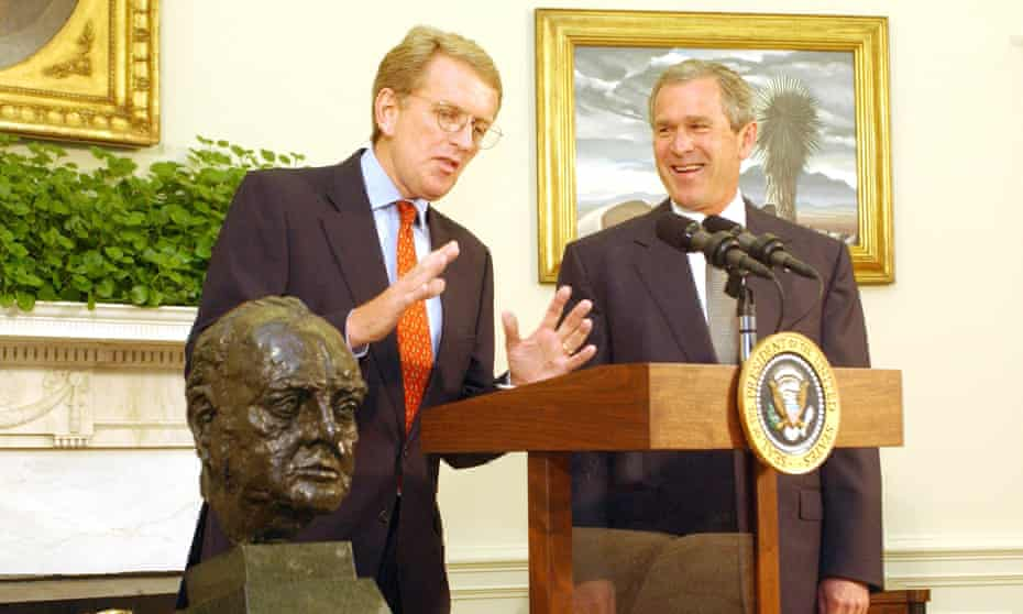 Former US president George W Bush accepts a loan of the Churchill bust from British ambassador Sir Christopher Meyer in the Oval Office in 2001.