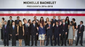 Chile's then President-elect Michelle Bachelet shows off her new cabinet in Santiago in 2014.<br>