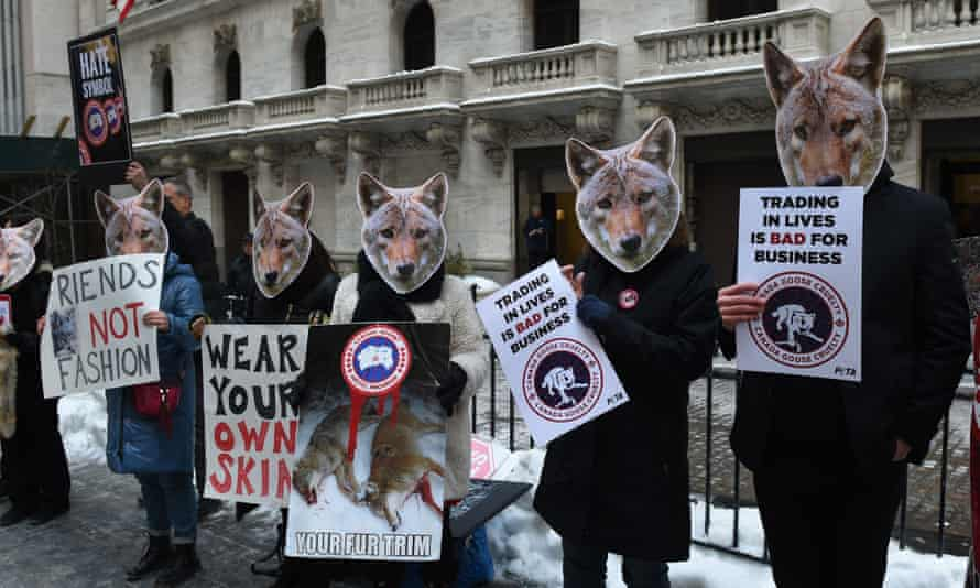 Animal rights campaigners protest against Canada Goose's use of fur outside the New York stock exchange in 2017