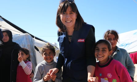Dr Joy Wright plays with children outside the Medair medical clinic in a camp near Kirkuk.