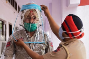 Police try personal protective equipment during a nationwide lockdown in Amritsar, India