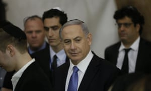 Netanyahu visits the Western Wall after his election victory. Barack Obama would call Netanyahu to congratulate him 'in the coming days', the White House said.
