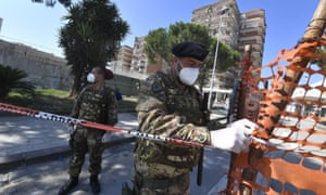 Italian soldiers secure a red zone in Mondragone, near Naples, where new 49 cases of coronavirus infections were confirmed.