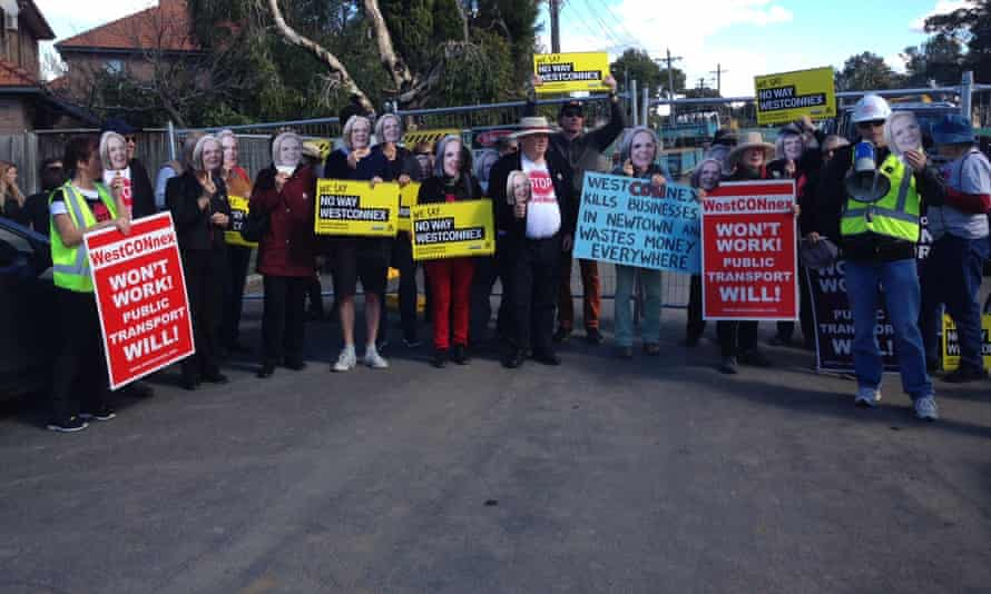 Protesters with the Stop WestConnex campaign wore masks of Lucy Turnbull's face at a demonstration in Sydney's inner west, on Saturday 20 August.