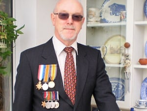 Mark Rogers, wearing his family's war medals