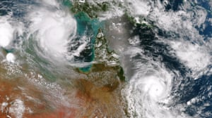 Cyclone Lam in the Arafura Sea and Cyclone Marcia off the east coast of Queensland, pictured from a satellite shortly before they both made landfall.