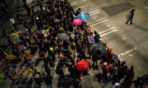 Demonstrators fill an intersection near the Seattle police east precinct in Washington on 26 July.
