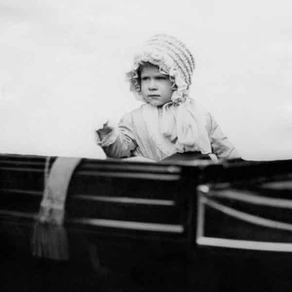 The then Princess Elizabeth waves from a carriage in London in 1928