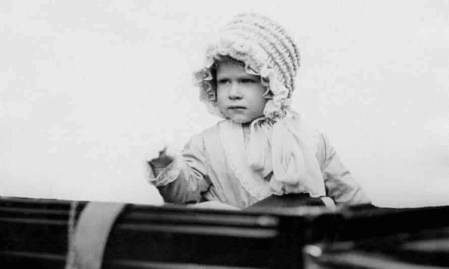 the queen as a toddler waves from a car